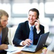 Business man speaking on the phone while in a meeting — Stock Photo #4813795