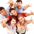 Top view of young friends with hands raised — Stock Photo