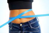 Measure tape around slim beautiful waist. — ストック写真