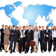 Businessmen standing in front of an earth map — Stock Photo #4823808
