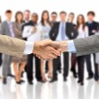 Handshake isolated on business background — Photo