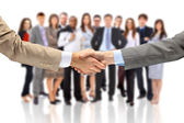 Handshake isoliert auf business-hintergrund — Stockfoto