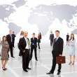 Businessmen standing in front of an earth map — Stock Photo #4839317