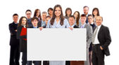Group of business holding a banner ad isolated on white — Stok fotoğraf
