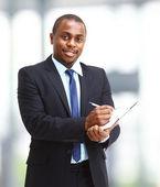 Porträtt av en stilig framgångsrikt företag man upptagna med att arbeta — Stockfoto
