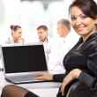 Business woman with team working on laptop — Stock Photo #4855714