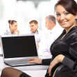 Stock Photo: Business woman with team working on laptop