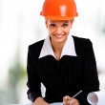 Smiling young female architect holding blueprints isolated on white backgro — Stock Photo