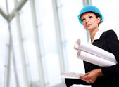 Female architect holding blueprints — Stock Photo