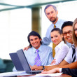 Group of happy business in a meeting at office — Stock Photo #4875145