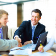 Business shaking hands, finishing up a meeting - Foto Stock