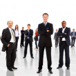 Business man leading a team isolated over a white background — Stock Photo #4875904