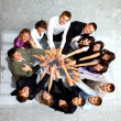 Top view of business with their hands together in a circle — Stock Photo #4909217