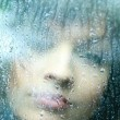 Sad young woman and a rain drops — Stock Photo