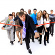Businesspeople crossing the finish line — Foto Stock