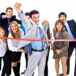 Businesspeople crossing the finish line — Stock Photo