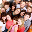 Top view portrait of happy men and women standing together and smiling — Stock Photo #4909475