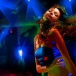 Beautiful young woman dancing in the nightclub — Stock Photo #4909525