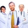 Portrait of group of smiling hospital colleagues standing together — Stock Photo #4909566