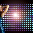 Beautiful young woman dancing in the nightclub - Stock Photo