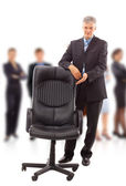 Contemporary office chair and businessman — Stock Photo