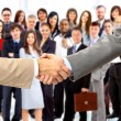 Handshake isolated on business background — Stock Photo #5032624