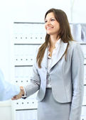 Business woman shaking hands with a man in her office — Stock Photo