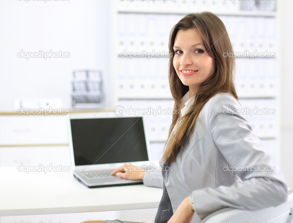 Business woman showing blank laptop  Stock Photo #5046988