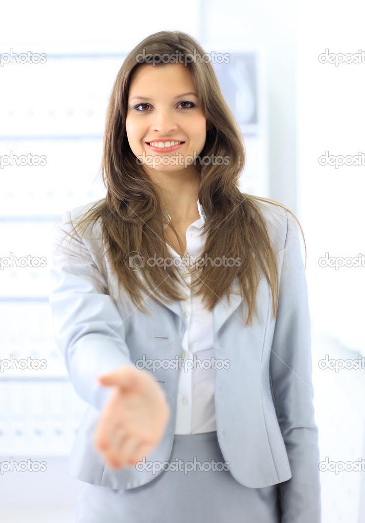Woman with an open hand ready for handshake — Stock Photo #5047024