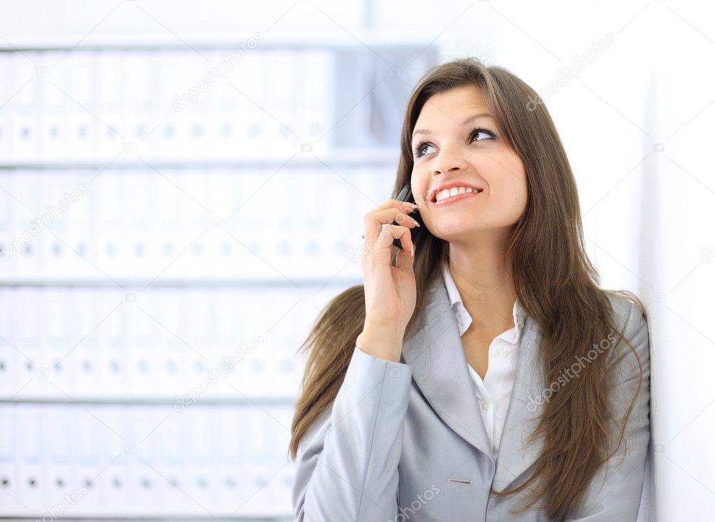 Beautiful business woman talking on cell phone while looking at copyspace  — Stock Photo #5047030