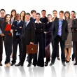 Business team formed of young businessmen standing over a white background — Stock Photo
