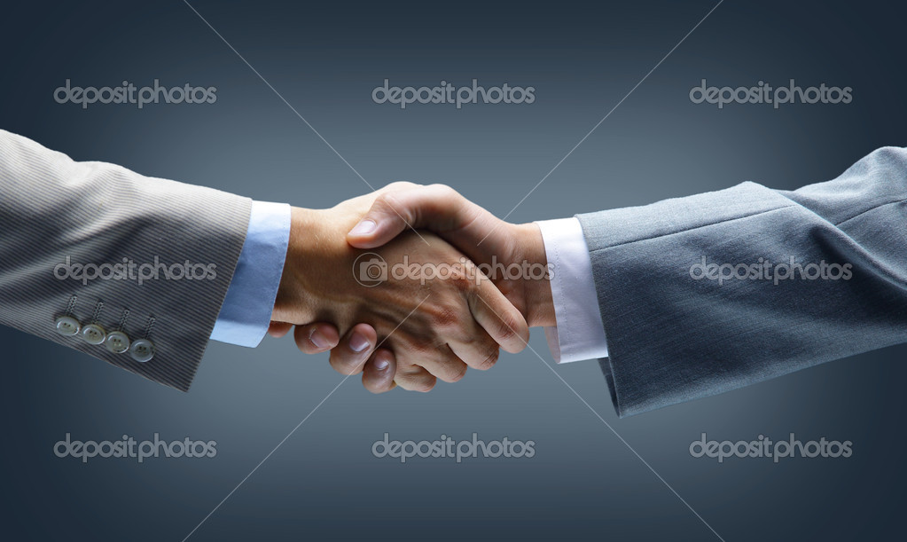 Handshake - Hand holding on black background  — Stock Photo #5052292