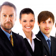 Confident mature business man with his staff discussing at the background — Stock Photo #5062737