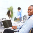 Постер, плакат: Portrait of a happy African American entrepreneur displaying computer lapto