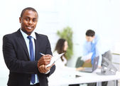 Portrait of a handsome successful business man busy working — Stock Photo