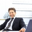 Happy businessman in office — Stock Photo #5140863