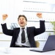Happy businessman in the office — Stock Photo #5140880