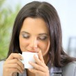 Portrait of relaxed businesswoman holding a cup of coffee in her office at — Stock Photo #5149425