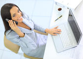 Beautiful businesswoman talking on the phone in the office — Stock Photo