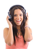 Portrait of a beautiful girl listening to music on her big headphones over — Stock Photo