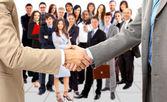 Aperto de mão isolado em fundo de negócios — Fotografia Stock