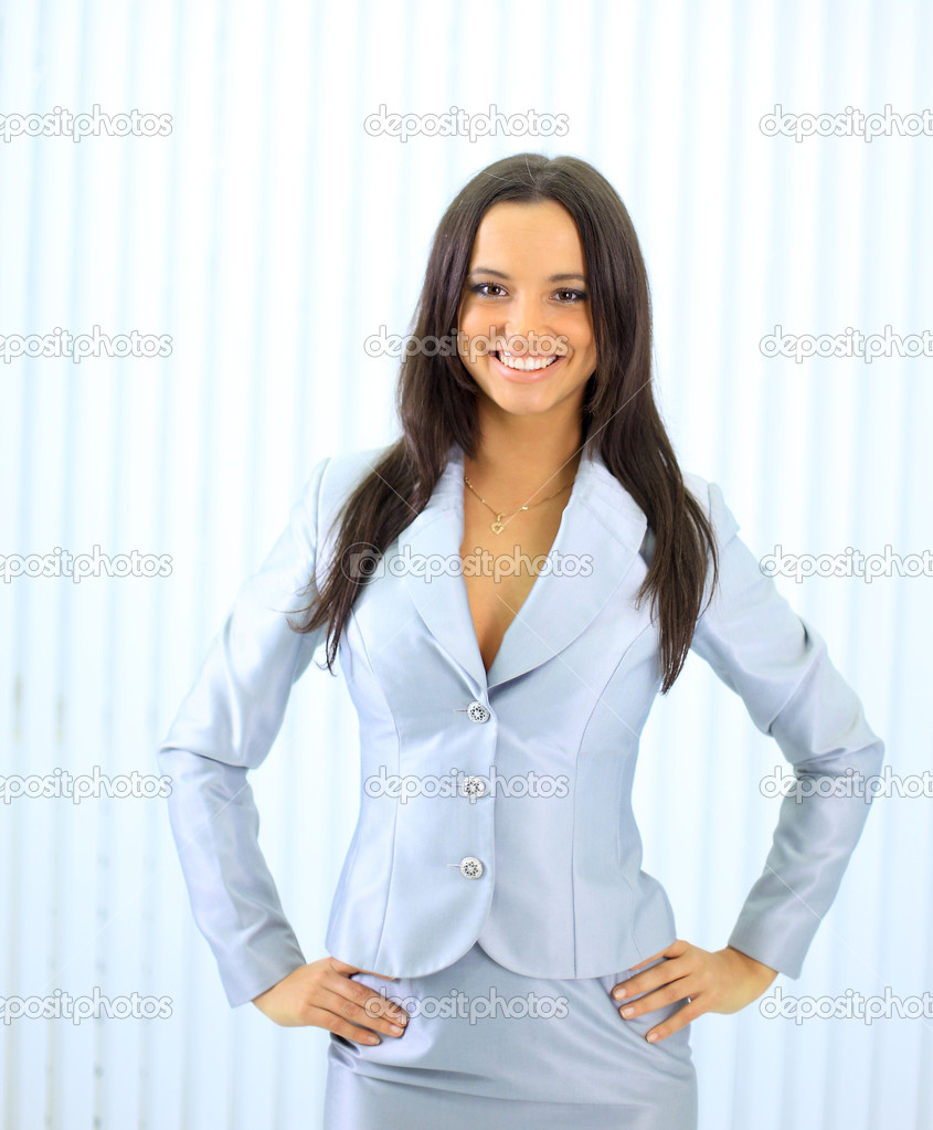 Young happy smiling businesswoman at office  — Stock Photo #5140467