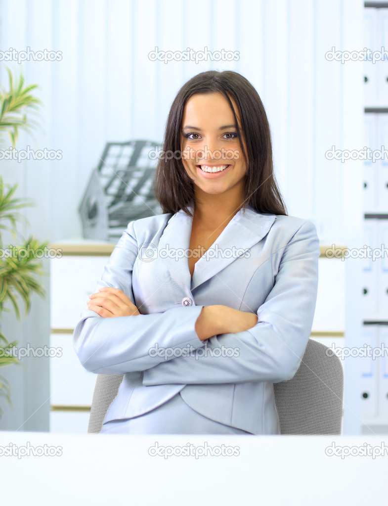 Beautiful business woman smiling at the office — Stock Photo #5140485