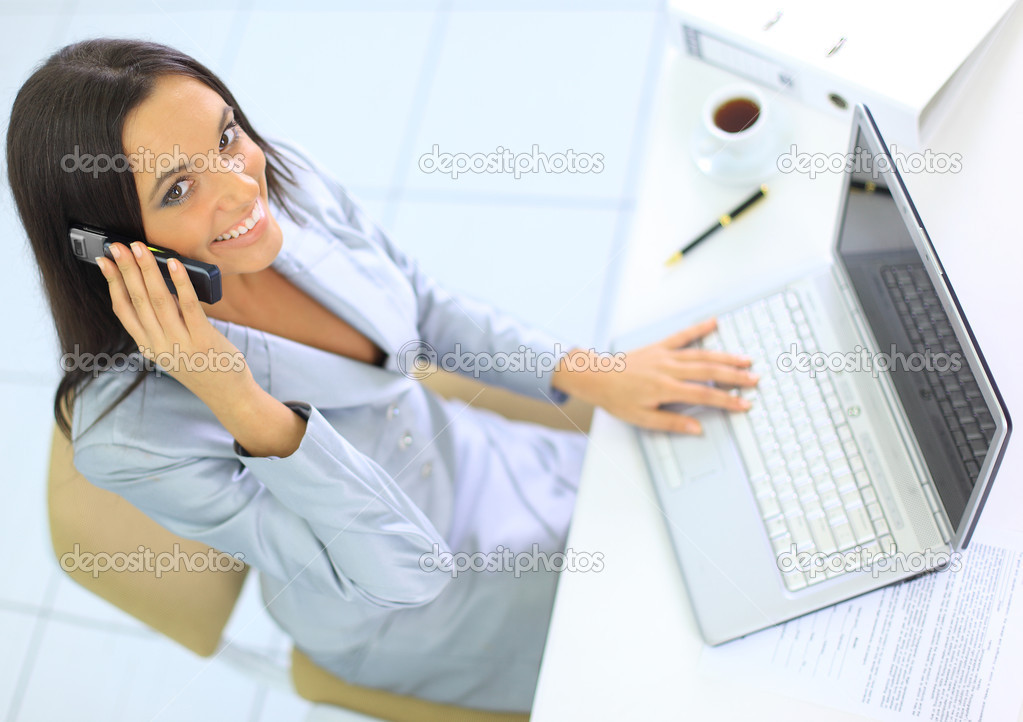 Beautiful businesswoman talking on the phone in the office  — Stock Photo #5140626