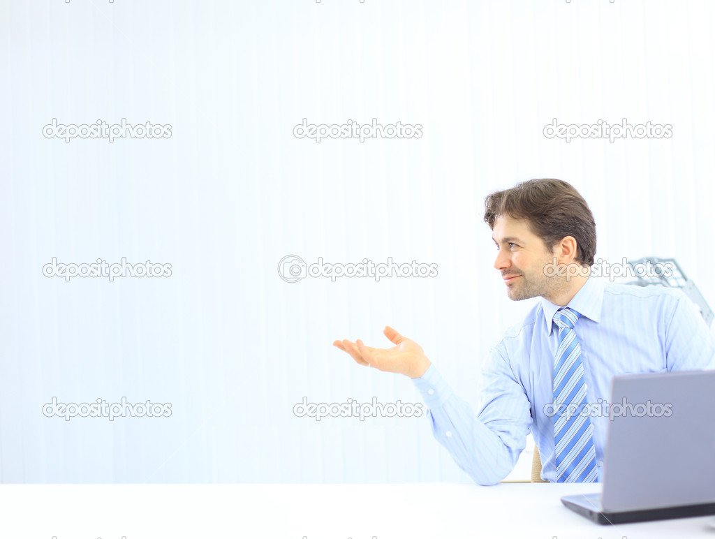 Young and confident business man with a laptop at the office  — Stock Photo #5140939