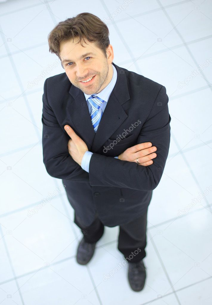 Portrait of a handsome elderly business man standing isolated on white background   Stock Photo #5141257