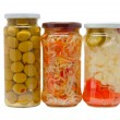 Glass jars with marinated vegetables  isolated o — Stock Photo