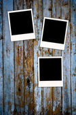 Three Blank Photos on Grungy Background — Stock Photo