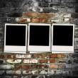 Three Blank Photos on Brick Background — Stock Photo