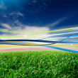 Foto Stock: Ribbons in Wind in Green Field